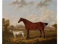 a bay hunter and a greyhound in a landscape with a manor house beyond by charles towne