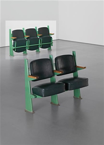 row of three lecture theatre chairs with adjustable seats designed for the faculté de lettres université de besançon by jean prouvé