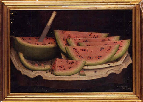watermelon wedges on a white platter on a marble topped table by daniel mcdowell
