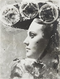 profile portrait with glasses and hat by dora maar
