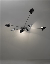 rare seven-armed wall light with casquette shades by serge mouille