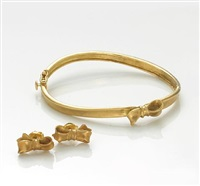 a bow motif bracelet together w/a pair of earrings (set of 2) by angela cummings