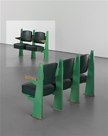 row of two lecture theatre chairs with adjustable seats designed for the faculté de lettres université de besançon by jean prouvé