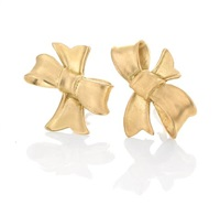 a pair of bow earrings by angela cummings
