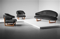 sculpture' sofa and pair of armchairs by jean royère