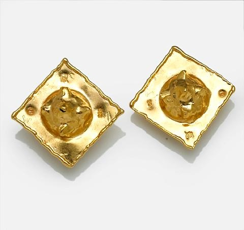 a pair of square earrings by jean mahie