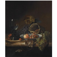 still life of blue and white grapes, a peach and strawberries in a porcelain bowl and basket, together with cherries and a roemer, all on a marble ledge by barend van der meer