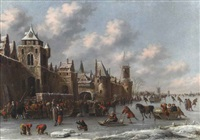 a winter landscape with figures skating and sledging on a frozen moat by a fortified town by thomas heeremans