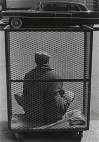 man sitting in cart, n.y. by roy decarava