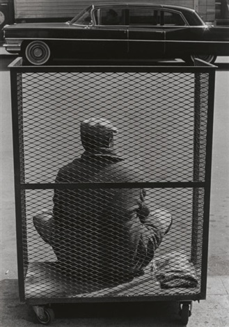 man sitting in cart ny by roy decarava