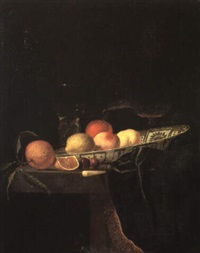 still life with peaches and other fruit and a glass on a draped table by hendrick van streeck