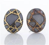 a pair of earrings by angela cummings