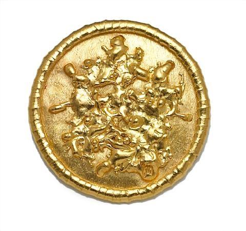 a brooch of circular, textured motif by jean mahie