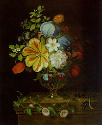 flowers in a glass vase with blackcurrants on a ledge by martin van dorne