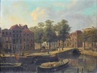 a dutch townscape with barges on a canal by fredericus theodorus renard