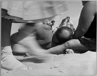 coney island (man lying on beach) by leon levinstein