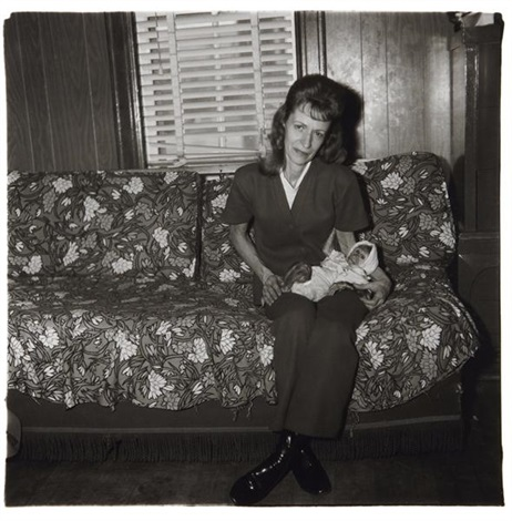 a woman with her baby monkey nj by diane arbus