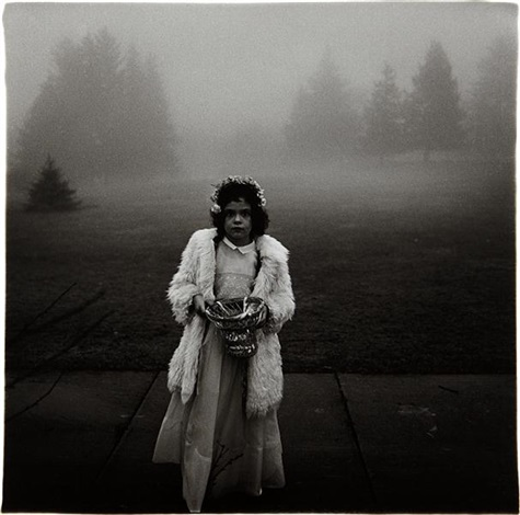 a flower girl at a wedding conn by diane arbus