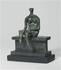 seated figure on a ledge by henry moore