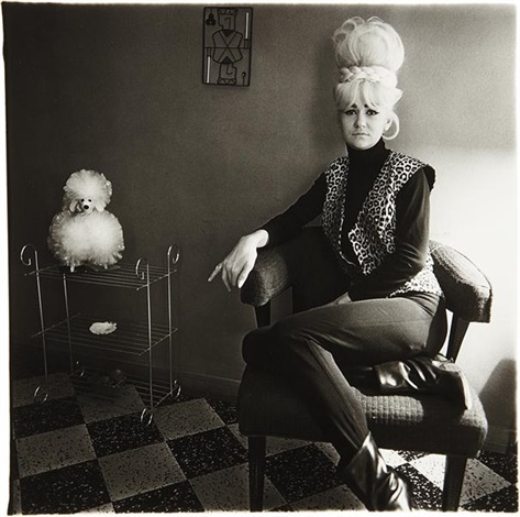 lady bartender at home with a souvenir dog new orleans by diane arbus