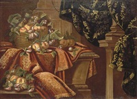 figs, grapes, apples and plums in a wicker basket on a partly-draped plinth, with other fruit on a ledge, beneath an embroidered hanging by master of the floridiana