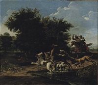 a deer hunt in a wooded landscape by pauwels van hillegaert
