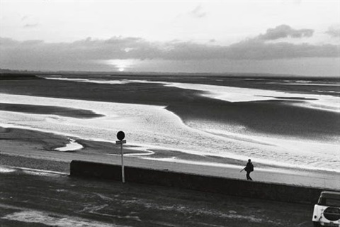 beach and a lone figure scene through a window smllr 2 works by henri cartier bresson