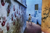boy in mid-flight, india by steve mccurry