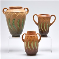 brown falline two-handled vases: two brown, one blue (3 works) by roseville