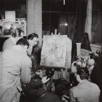 salvador dali réalisant l''illustration l''hostie du livre l''apocalypse à la galerie du quai d''orsay ( 2 works) by paul almasy