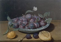 still life of a plate of plums and a loaf of bread by jacques linard