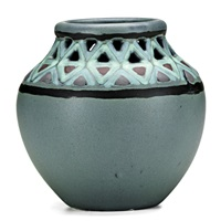 reticulated vase with geometric designs on blue-green ground by j. d. wareham
