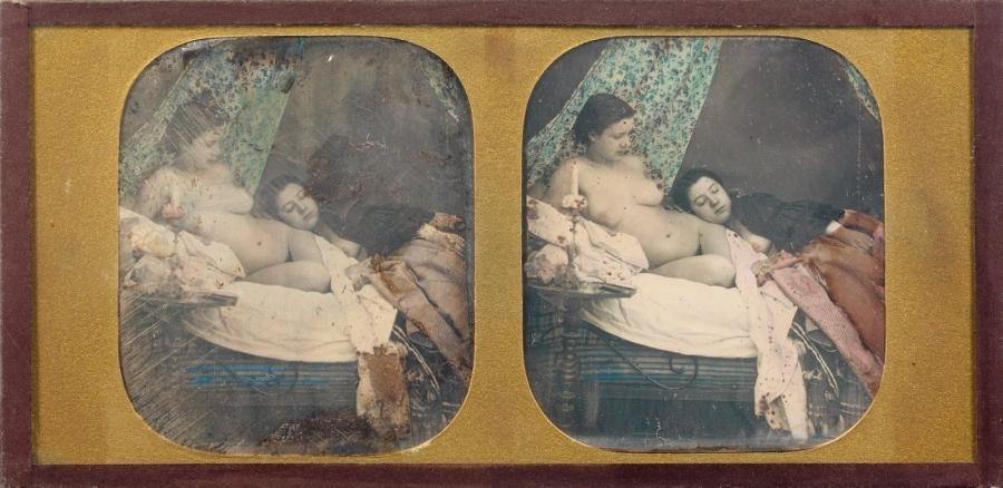 deux jeunes femmes allongées, l'une nue et l'autre portant une cape sur les épaules dévoilant son sein by joseph auguste belloc