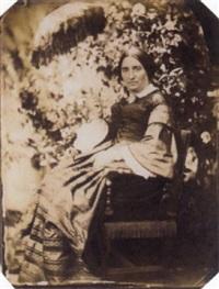 femme à l'ombrelle dans un jardin by jean baptiste frénet