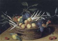 stilleben mit einem korb mit marillen, zwetschken, kirschen, spargel und rettichen auf einer tischplatte by isaac soreau