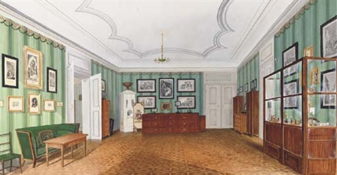 a german interior decorated with prints and furnished with cabinets and a small office by a zegnard