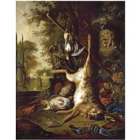still life with dead game and an ornate vase by dirk valkenburg