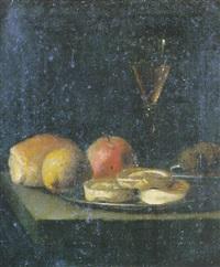 nature morte aux plats de biscuits, fruits, noix et verre de vin sur un entablement by hendrick van streeck