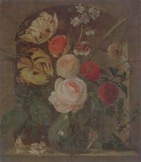 still life of various flowers in a glass vase, set in a niche by coenraet (conrad) roepel