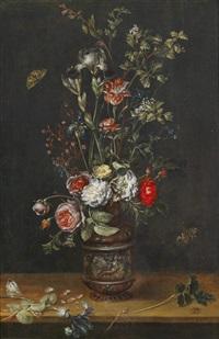 blumenstrauß mit rosen, tulpen, iris, und einer mimose in einer ornamental verzierten tonvase by alexander adriaenssen the elder