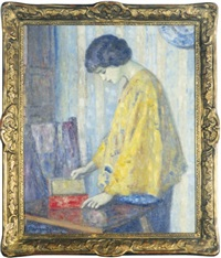 woman in a yellow shawl opening a box by paul renaudot