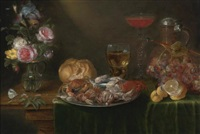 a still life with a platter of crabs and shrimp, a glass jug of flowers, a roemer and a long-stemmed tazza of wine, an earthenware jug, a loaf of bread, a bunch of grapes and a half-peeled lemon by alexander adriaenssen the elder