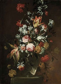tulips, roses, amaranthus, carnations and other flowers in a glass vase on a stone ledge by giuseppe vicenzino