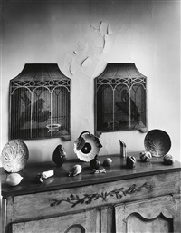 still life (interior with cabinet, ceramic vegetables and trompe-l'oeil birdcage paintings) by andré kertész
