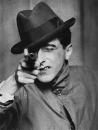 jean cocteau with gun, new york by berenice abbott