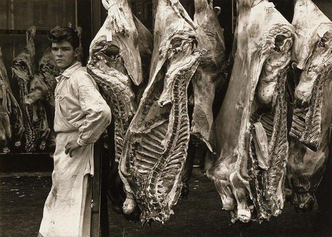 jeune boucher aux halles de paris by guy bourdin