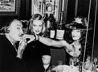 salvador dali, janet daly and the recipient of a kiss, restaurant laurent, nyc, new years eve, by roxanne lowit
