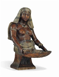 bust of a nubian girl holding a shell dish by friedrich goldscheider