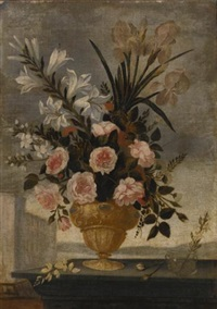 still life of iris, lilies, roses and carnations in elaborate urn, with a blue and white cup and a small glass vase, landscapes beyond (pair) by pedro de camprobin
