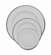 a french porcelain part dinner service by limoges